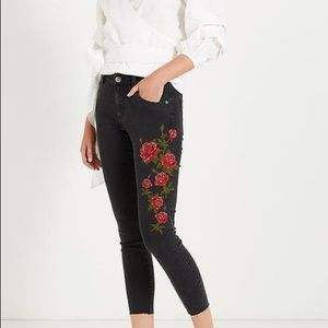 Never worn black rose embroidered skinny jeans